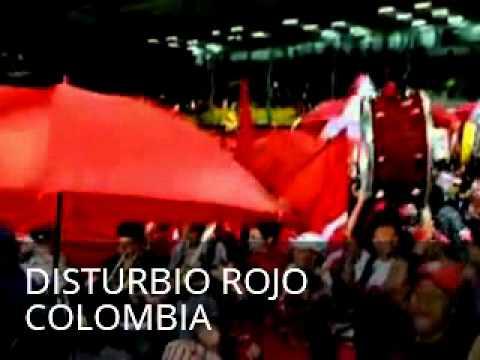 """DISTURBIO ROJO COLOMBIA"" Barra: Disturbio Rojo Bogotá • Club: América de Cáli"