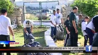 Xogħol volontarju minn Maltin u Asjatiċi fil-ġnien ta' Dar il-Kaptan