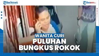 Rekaman CCTV Seorang Wanita Curi Puluhan Bungkus Rokok di Toko Kelontong