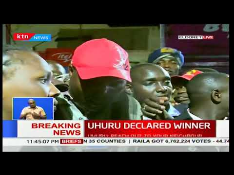 Eldoret residents react after Uhuru Kenyatta was declared president-elect in Kenya's 2017 poll
