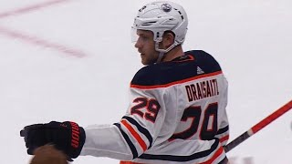 Draisaitl wins face off, takes pass from Lucic and scores