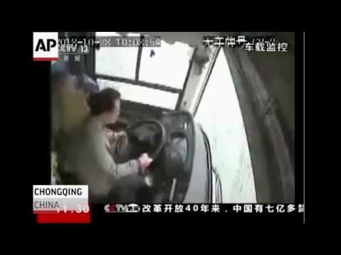 Police say a brawl between a passenger and a bus driver was the cause of the bus plunging off a bridge and into a river in southwestern China. At least 13 people died in the crash. (Nov. 1)