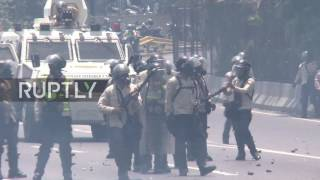 Venezuela: Tear gas flies in Caracas as death toll during anti-govt. protests rises