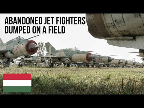 Abandoned Jet Fighter dump found on a field.