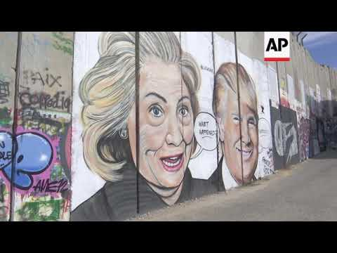 Picture politics adorn Israel's security wall