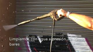Limpieza de grafitis de persiana protegida con PLX CRISTAL COLOR