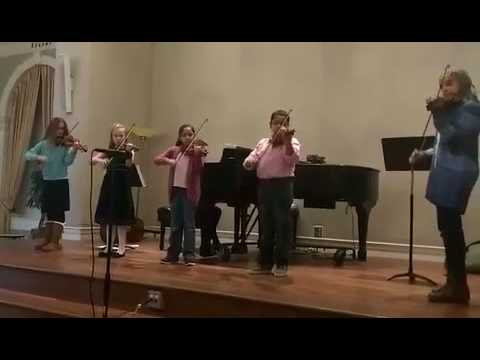 Performance of O Come Little Children by a group of students