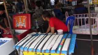 preview picture of video 'Lottery and other market stalls at Wat Sothonwararam Worawihan - Chachoengsao , Thailand ฉะเชิงเทรา'