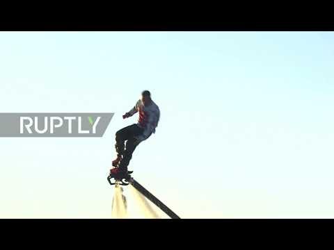 Sky's the limit! Watch dozens of daredevil-flyboarders soar over Volga River