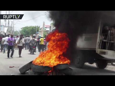 Police uses rubber bullets & tear gas to disperse protesters in Haiti