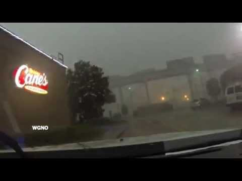 Train blown off of bridge during a thunderstorm in New Orleans