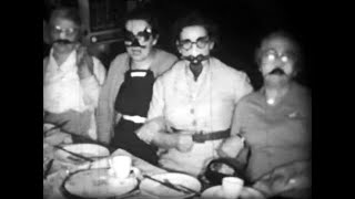 Feestend gezelschap, begin jaren '60