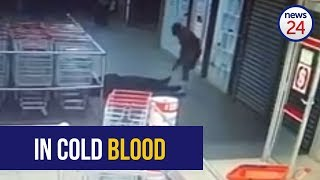 """A security guard was shot dead when a gang of 15 men robbed a Shoprite supermarket in Heidelberg, south of Johannesburg on Friday evening.  Video shows the guard involved in a scuffle with one of the robbers at the entrance of the Ratanda Shopping Centre.  While the security guard and robber struggled over the firearm, two more robbers entered the shop.  Both men shoot the security guard at close range, before more men enter and rob the premises.  The group got away with an undisclosed amount of money.  According to police, officers responding to the scene confronted the gang some distance from the shop and an exchange of gun fire ensued.  Police spokesperson Sergeant Lerato Mngomezulu told News24 that one officer and a Fidelity security guard were shot in the cross fire Both were rushed to hospital.  """"The Cluster task team managed to arrest a male in possession of a firearm during follow-up operations,'' she said.  In a statement to News24, The Shoprite Group has confirmed they are working closely with police's Provincial Investigation Unit (PIU) of the South African Police Service.  """"The Supermarket chain expresses its condolences to the guard's family and is supporting them during this time. Staff members are being counselled to assist them to recover from this terrible ordeal,'' the statement said.    Subscribe to News24: https://www.youtube.com/user/News24Video"""