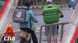 Desmond Lee meets food delivery riders affected by e-scooter footpath ban