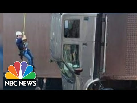 Couple And Dogs Rescued From Truck Dangling Off Idaho Bridge | NBC Nightly News
