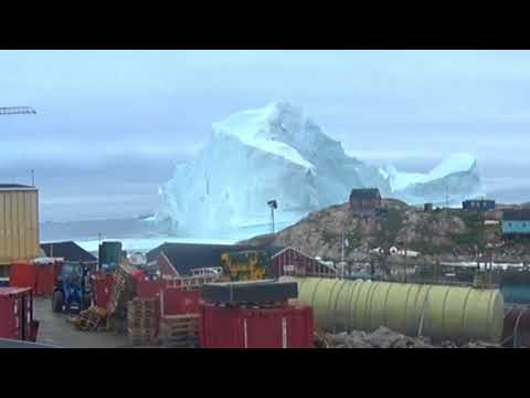 11 Million Ton Iceberg approaches town of Innaarsuit, Greenland.