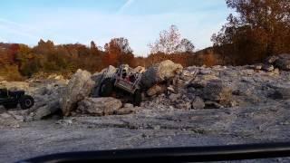 Ray climbing a rock pile at Disney