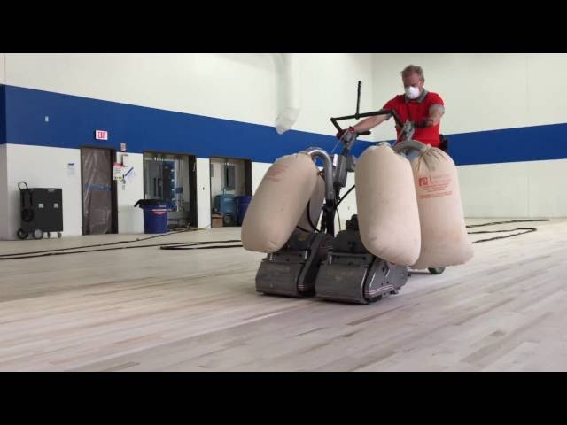 "Gym floor sanding with rider and 2 12"" machines"