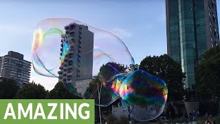 Bubble artist dazzles crowd with massive floating bubbles