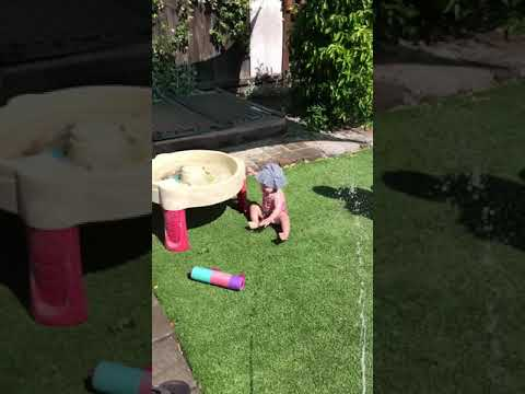 Finley's first steps through the sprinkler!