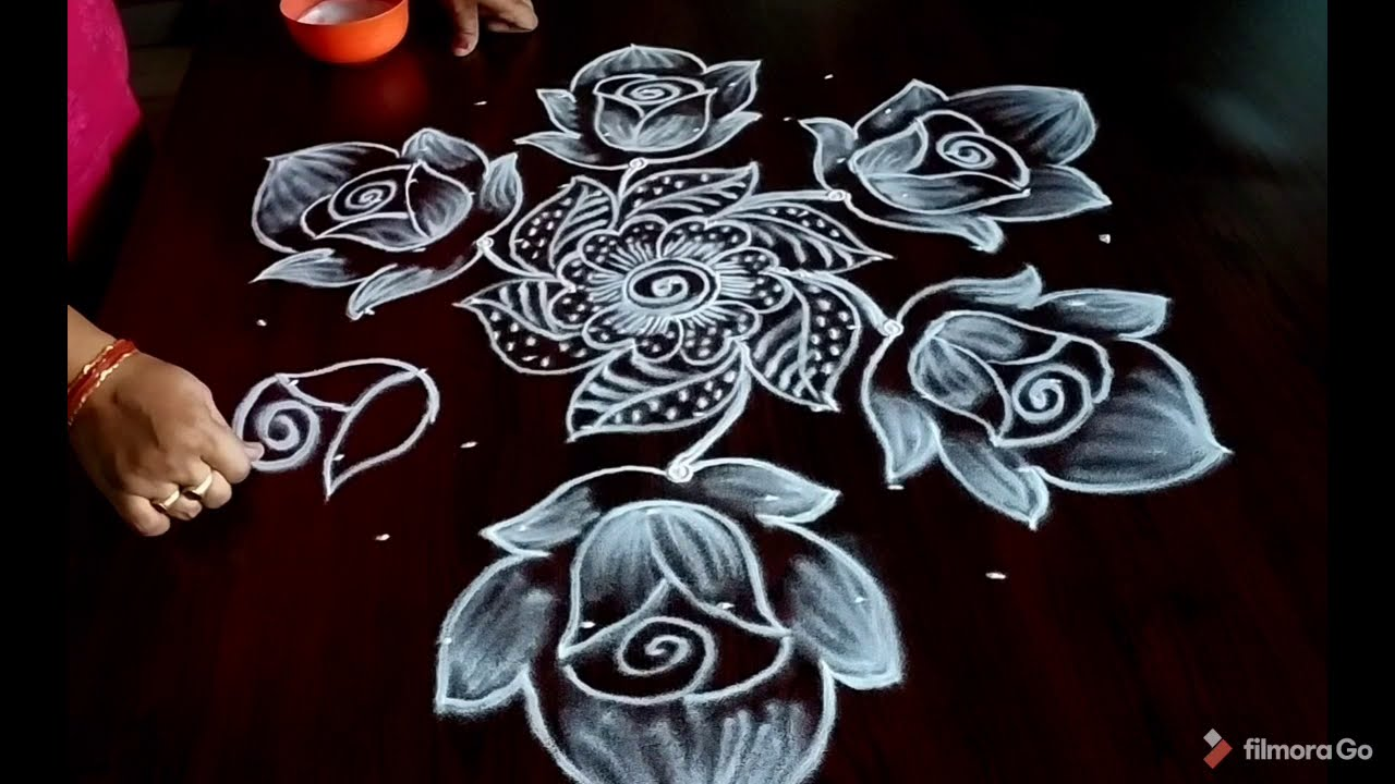 simple rose flower rangoli design with 9 dots by aryaani designs