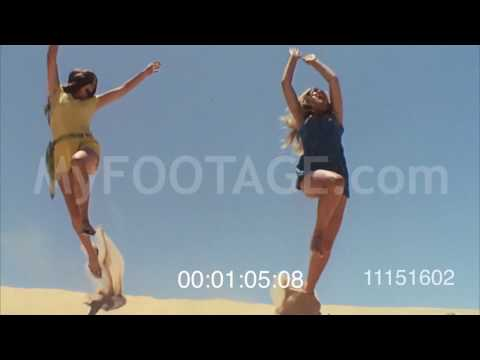 1970s Girls Jumping on Sand Dunes