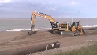 BIG Caterpillar bulldozer machines at work on a beach MUST SEE