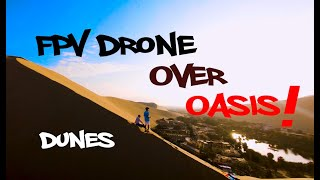 FPV drone flying over an oasis among sand dunes!!!