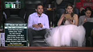 Wedding-dress clad Wild fan enjoys burger at game