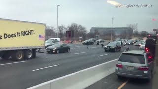 Drivers stop to chase money on N.J. highway