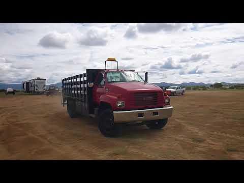2000 GMC C7500 Flatbed Truck | J & J AUCTIONEERS LLC