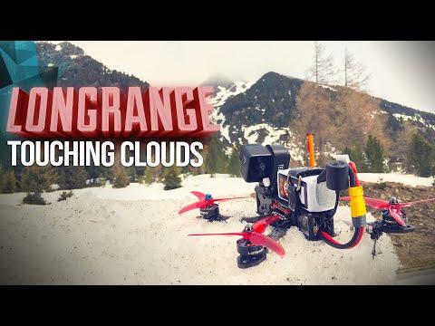 flight-through-clouds-on-a-mountain-peak--long-range-fpv-4k