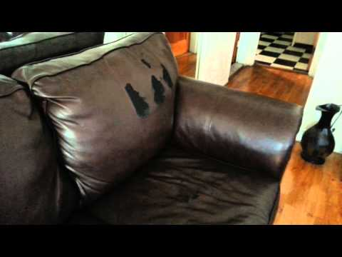 Bobs Discount Furniture - Purchased a black leather couch and love seat/cracked /ripped
