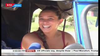 Foreigner drives tuk-tuk in Mombasa as part of her interaction with locals