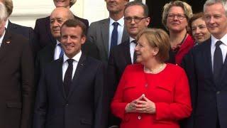 UE: Macron vole au secours de Merkel sur les migrants