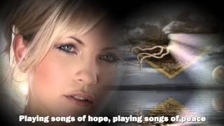 Bette Midler - From A Distance - Lyrics