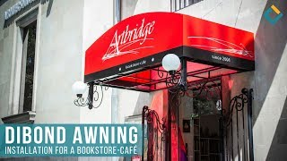 Dibond awning installation for a bookstore-cafe