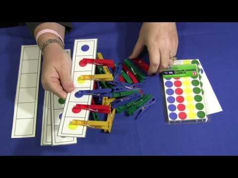 Screenshot of video: Peg / colour matching  activity
