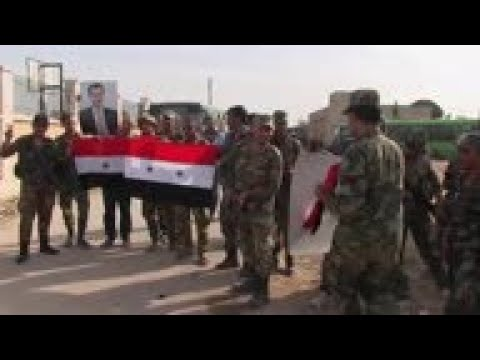 Syrian forces enter Manbij, raise national flag