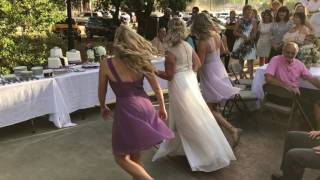 Bride mom and two daughters dance for groom