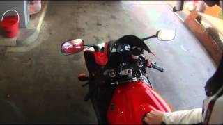 Filling bike up with petrol in December 2015, England