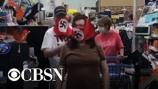 On Saturday, the first day of Minnesota's mandatory mask mandate, a man and a woman went shopping at a Walmart in Marshall -- population 15,000 -- wearing masks with swastikas. CBS Los Angeles reports.
