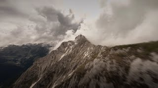 Mountain surfing in the clouds | 4K Cinematic FPV