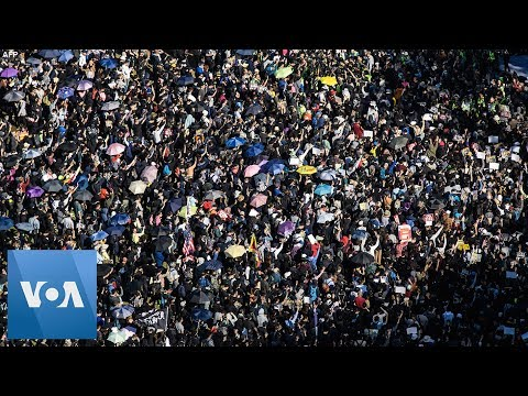 Thousands of Protesters Pack Hong Kong Streets to Mark Six Months of Anti-Government Movement