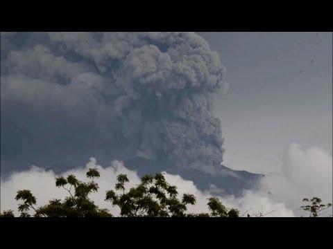 Thousands evacuated as Bali volcano spews smoke and ash