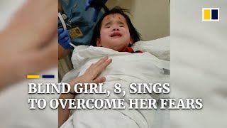 Blind girl, 8, sings to overcome her fears in hospital