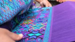 Maria weaving beautiful huipil