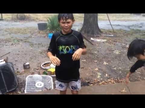 Redneck Children Bathing Outside in a Thundershower!