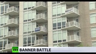 Banner battle: DC residents' balcony signs fuel political feud over Trump