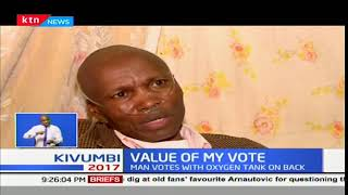 Meet the man who went to vote with an oxygen tank